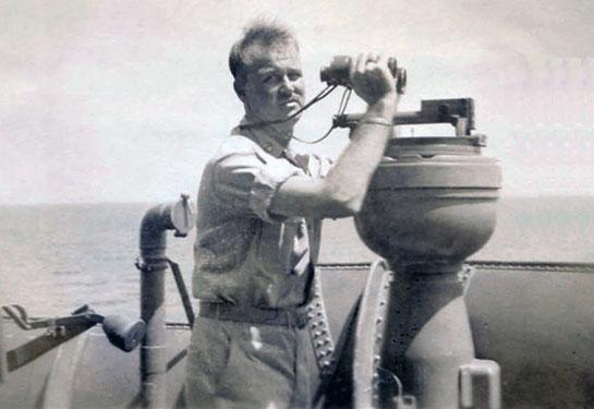WW-II-Crew-Photos-Man-with-binoc-at-compass